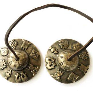 Tibetanske meditations klokker med lykke symboler