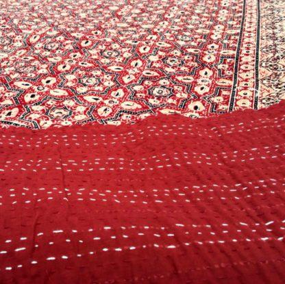 Rosa bomulds sengetæppe