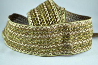 Løst vævet kantebånd i guld tråd 7 cm.