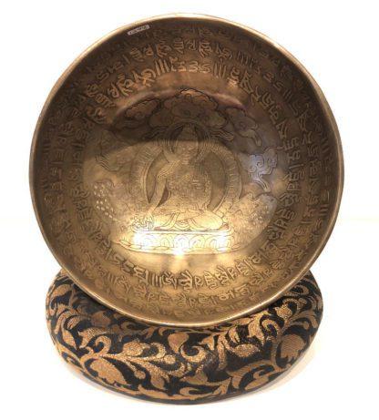 Tibetansk syngeskål med Buddha motiv