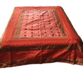 Orange sengetæppe i silke