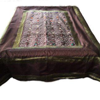 Brunt sengetæppe